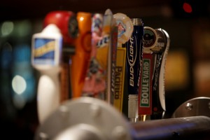 Local and craft beers on tap are half-off during happy hour at the bar.